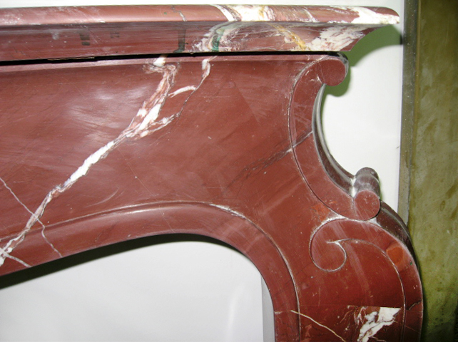 Red Asiago shaped fireplace