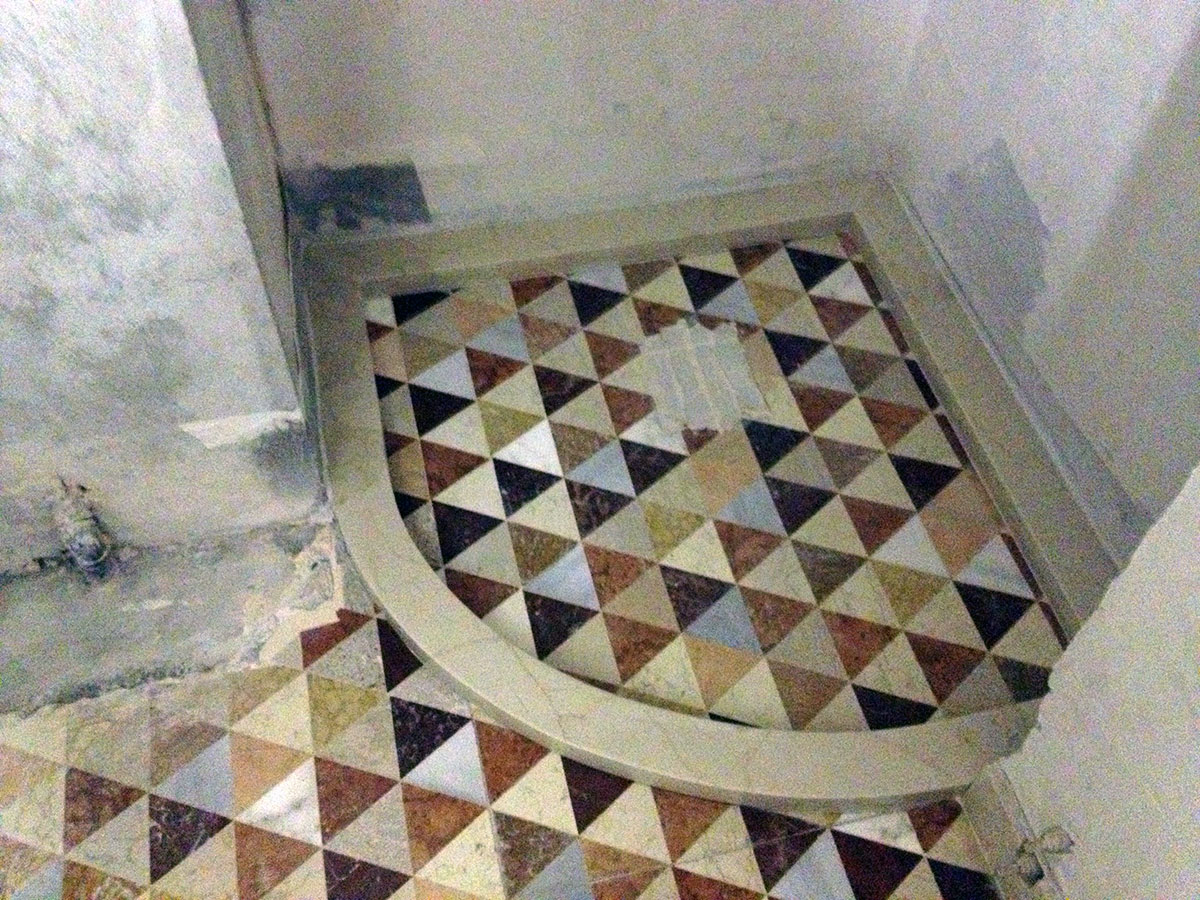 Polychrome marble shower base